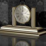 Reloj dorado de sobremesa con portaplumas El Casco